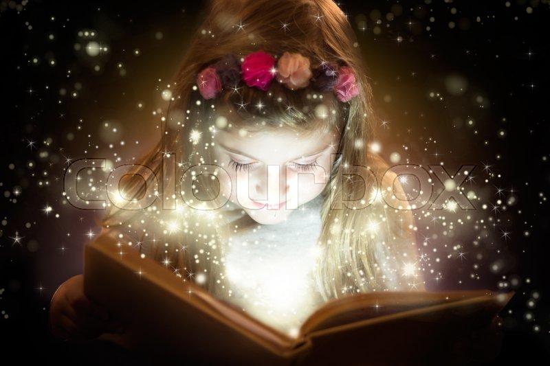 Little girl reading magic book fantasy   Stock Photo  Colourbox