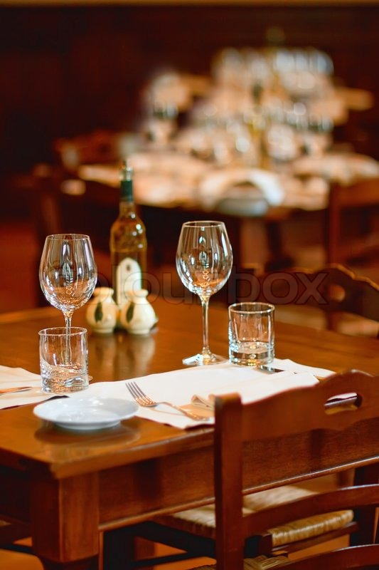 Wine glasses on a table in a restaurant  Stock Photo