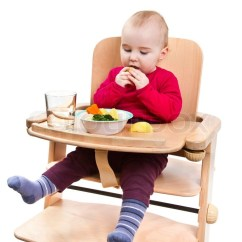 Baby Chairs For Eating Wooden Folding Sale Young Child In High Chair Stock Photo Colourbox