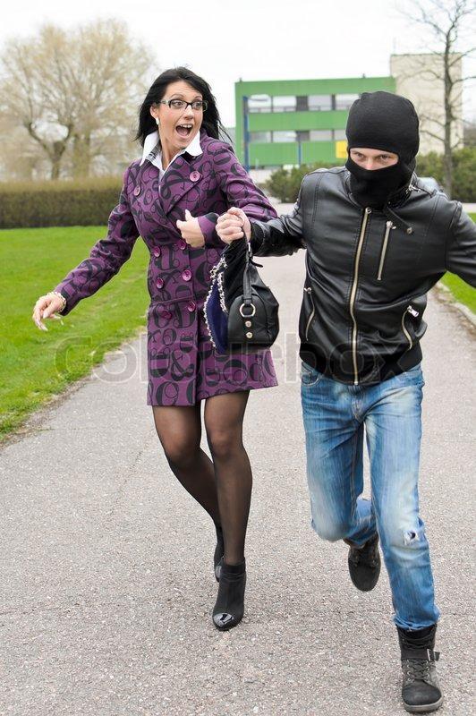 Daylight Robbery On The Street Thief Stock Photo