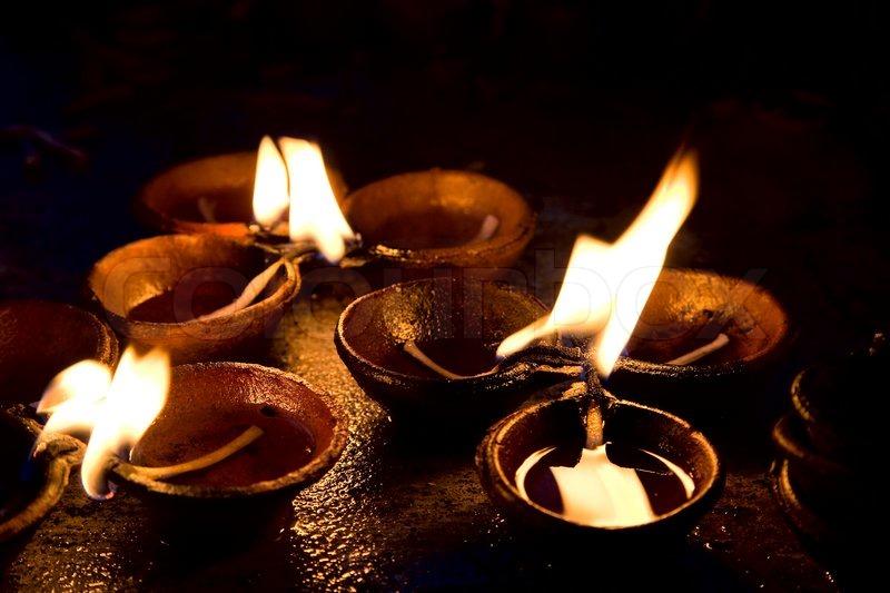 Burning candles on altarin buddhist temple Sri Lanka