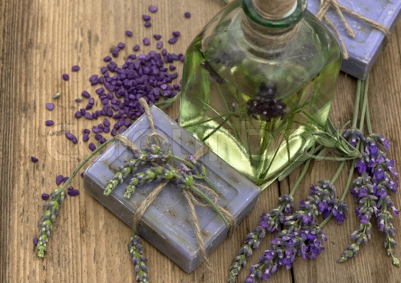 Essential Lavender Oil And Herbal Soap With Fresh Flowers