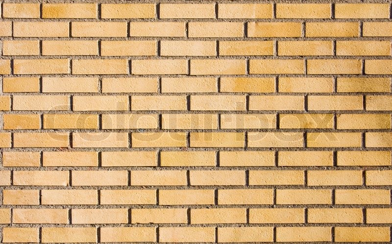 beige brick wall stock
