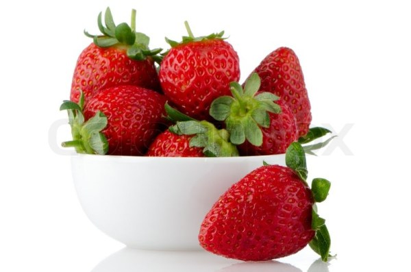 Fresh strawberries in bowl on white reflective background