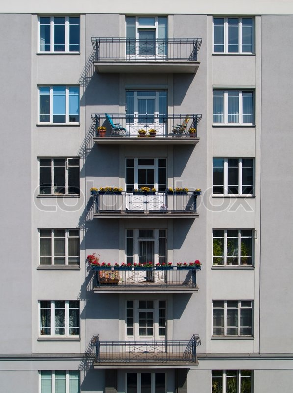 Windows on the wall of apartment building