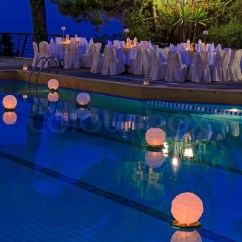 Orange Cafe Chairs Patio Chair Inserts Floating Water Lantern In The Pool | Stock Photo Colourbox