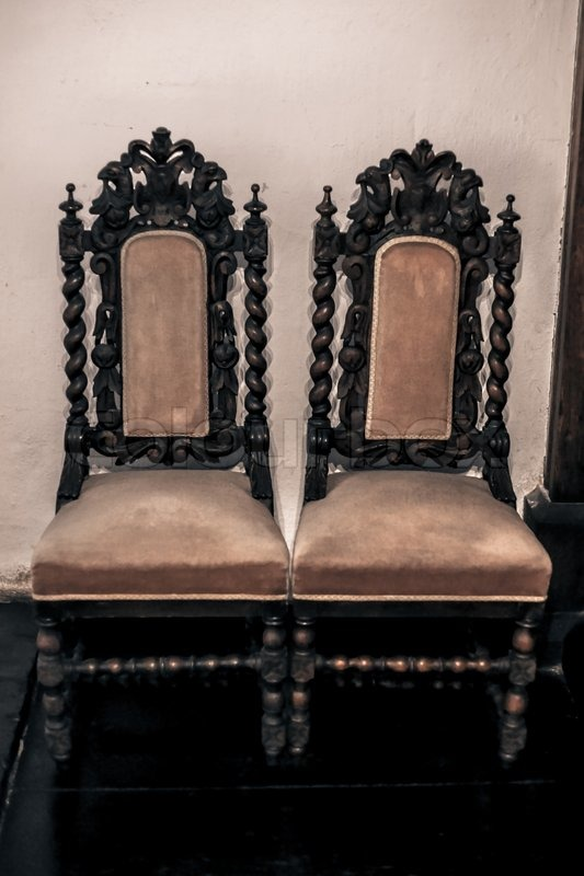 best color for living room with brown furniture cheap antique gothic chairs up against the wall | stock photo ...