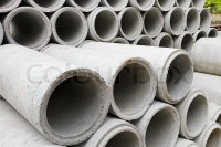 Stacked concrete drainage pipes | Stock Photo | Colourbox