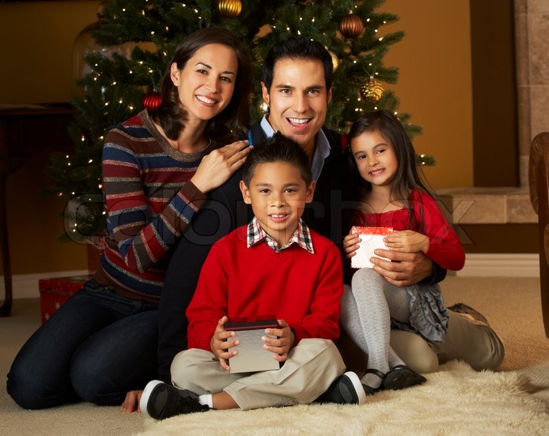 Family In Front Of Christmas Tree  Stock Photo  Colourbox
