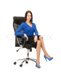 Businesswoman sitting in chair | Stock Photo | Colourbox