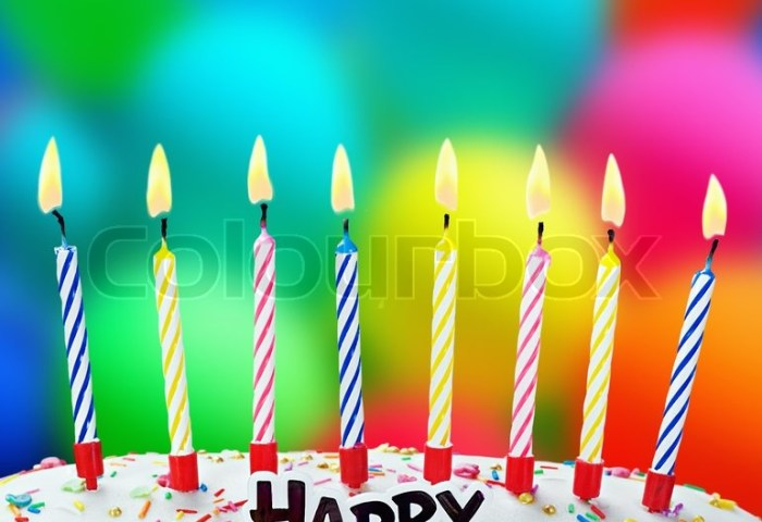 Burning Candles On A Birthday Cake On Stock Image Colourbox