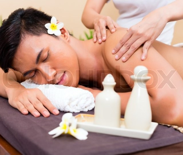 Indonesian Asian Man In Wellness Beauty Spa Having Aroma Therapy Massage With Essential Oil Looking Relaxed Stock Photo Colourbox