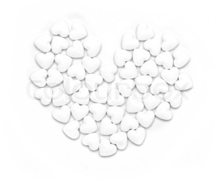 White pills form heart shape isolated on grey background