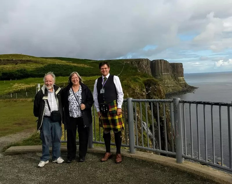 Andrew Baxter with visitors at Kilt Rock on Skye