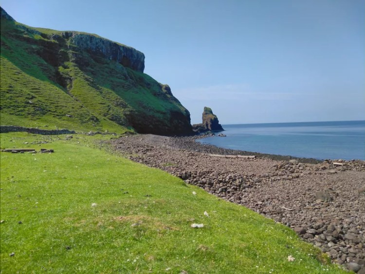 View of a beach and sea cliffs on Skye