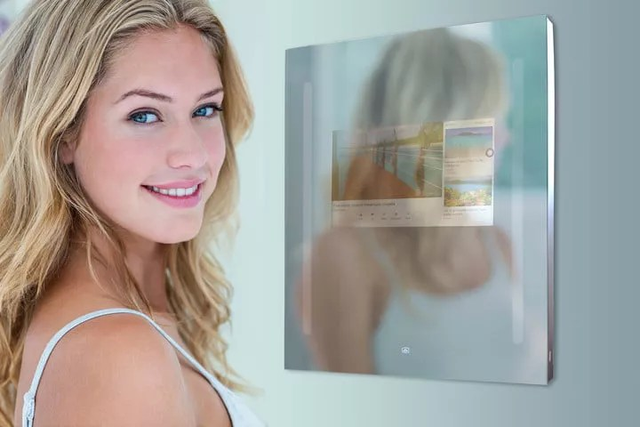 a girl in front of  a smart mirror