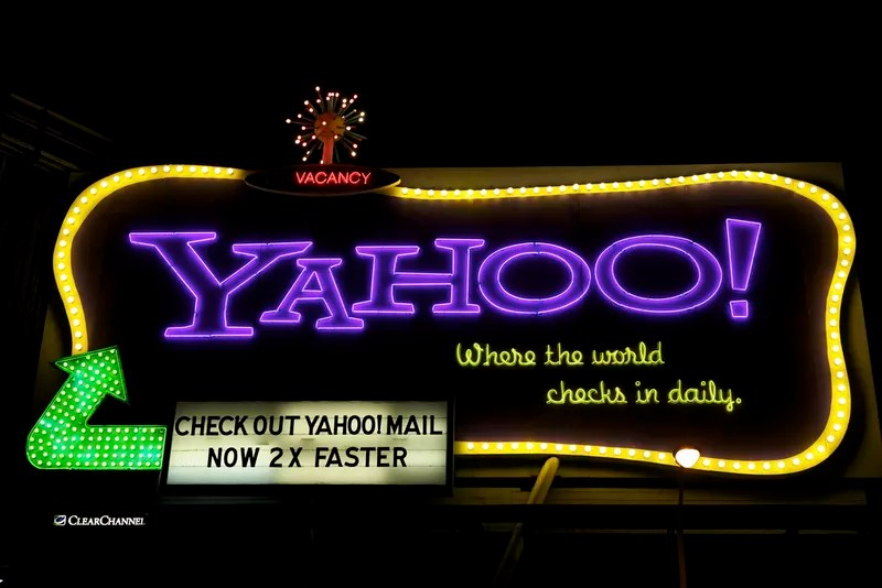 "Yahoo! neon billboard targeting small business owners commuting in California, reads ""where the world checks in daily."""