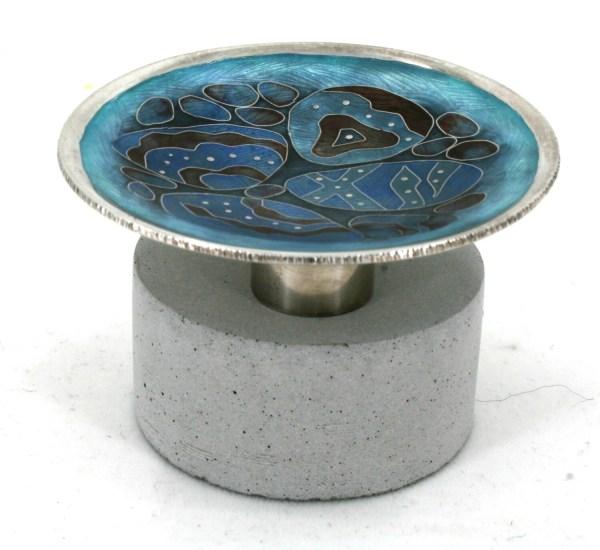 Tiny Silver Cloisonne enamel Pebble Pool Dish on a concrete base.