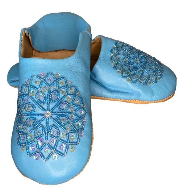 Light blue leather slippers with sequin decoration