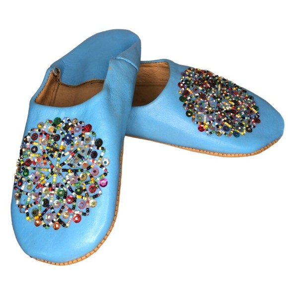 Light blue leather slippers with multi-coloured sequin decoration