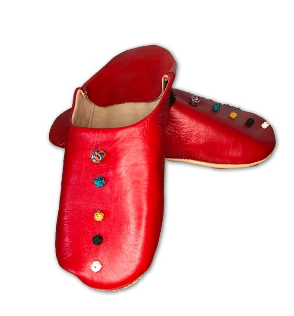 Red leather slippers with silk knot decoration