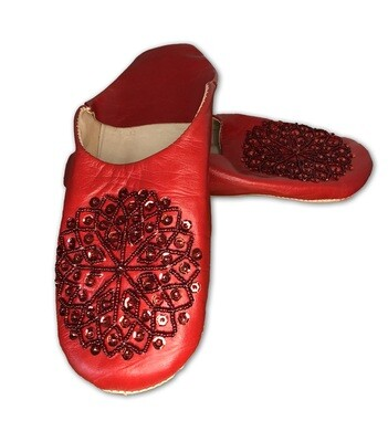 Red leather slippers with sequin decoration