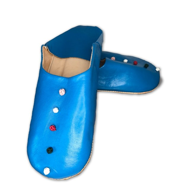 Blue leather slippers with silk knot decoration