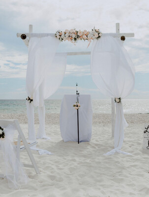 4 Post Bamboo Arch w/ White Chiffon Curtains
