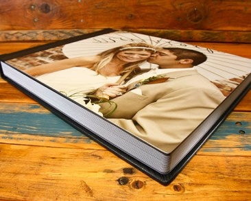 Newlywed couple kissing on the cover of a custom Metalic Photo Album