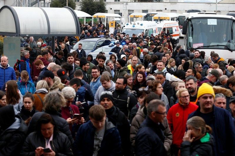 Passengers who were evacuated due to a fire at Ciampino Airport in Rome, Italy, February 19, 2019 gather outside the teminal building