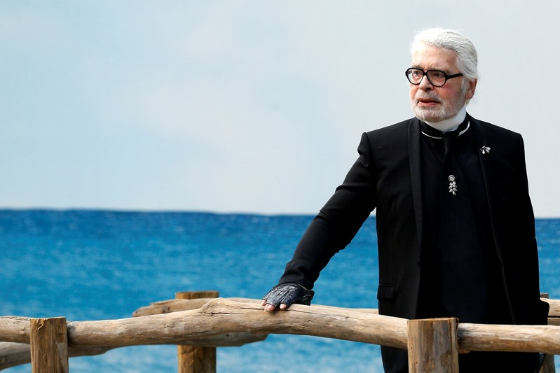 FILE PHOTO: German designer Karl Lagerfeld appears at the end of his Spring/Summer 2019 women's ready-to-wear collection show for fashion house Chanel during Paris Fashion Week