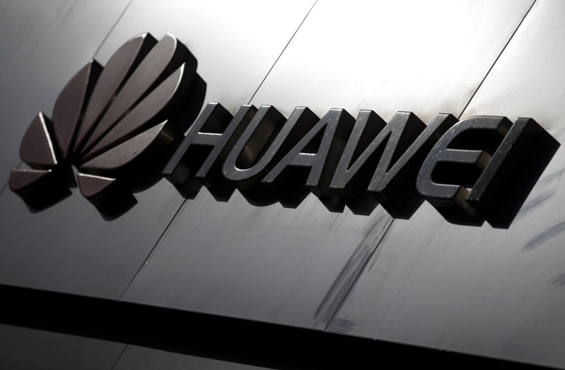 The Huawei brand logo is seen above a store of the telecoms equipment maker in Beijing
