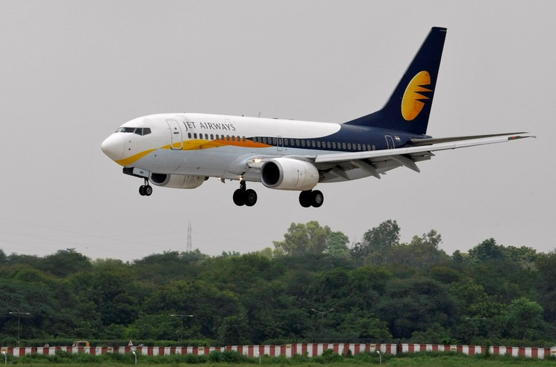 FILE PHOTO: Jet Airways passenger aircraft prepares to land at the airport in the western Indian city of Ahmedabad