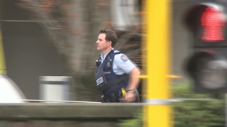 Video grab of a police officer running after reports that several shots had been fired at a mosque, in central Christchurch