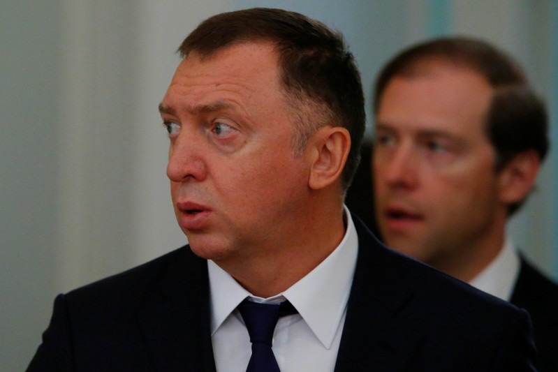 Russian aluminium tycoon Deripaska and Industry and Trade Minister Manturov arrive for the talks of Russian President Putin with South Korean President Moon in Moscow