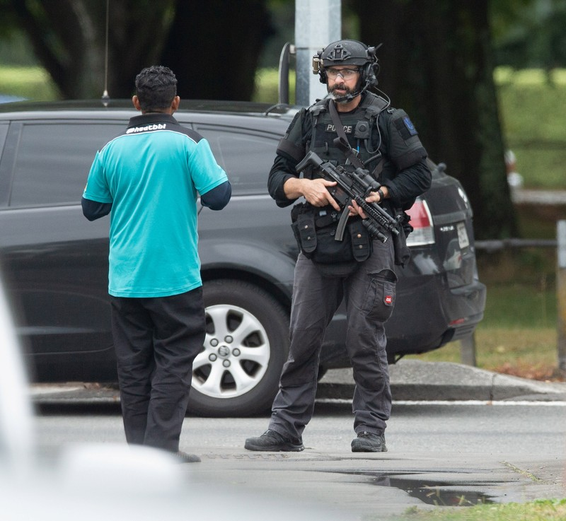 AOS (Armed Offenders Squad) push back members of the public following a shooting at the Al Noor mosque in Christchurch