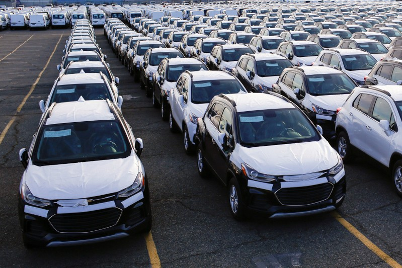 FILE PHOTO: Imported automobiles are parked in a lot at the port of Newark New Jersey