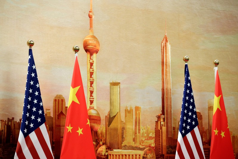 U.S. and Chinese flags are placed for a joint news conference in Beijing