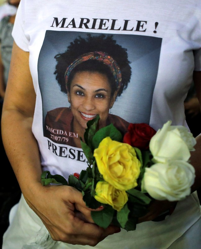 A woman attends a mass marking the first anniversary of activist and councilwoman Marielle Franco's murder, in Rio de Janeiro