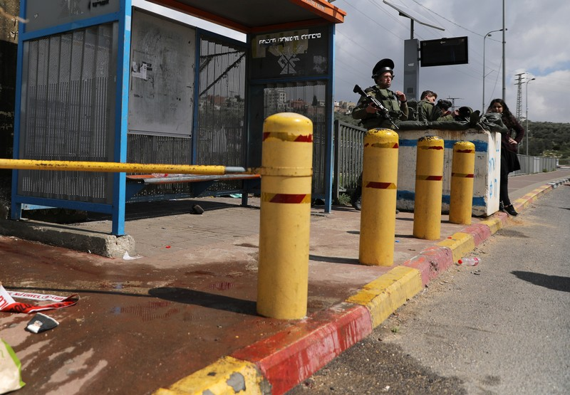 Israeli soldiers stand guard near the scene of Palestinian shooting attack near the Jewish settlement of Ariel, in the occupied West Bank