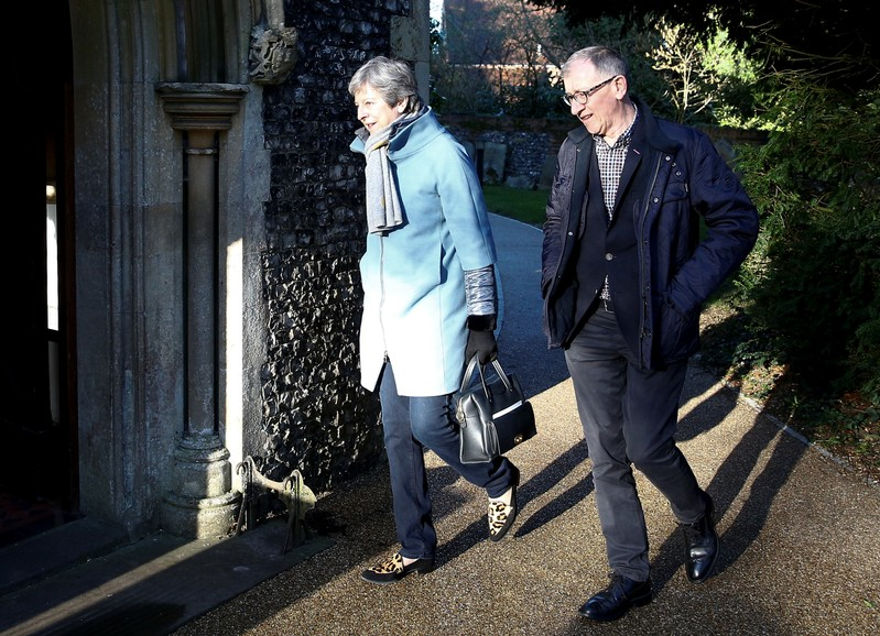 Britain's Prime Minister Theresa May and her husband Philip arrive at church in Sonning