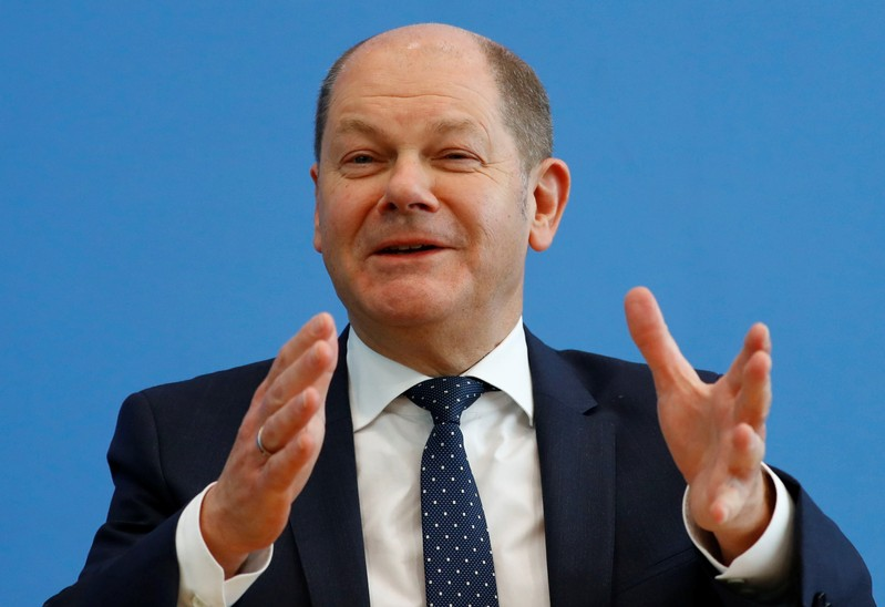 Finance Minister Olaf Scholz addresses a news conference to present the budget plans for 2019 and the upcoming years in Berlin