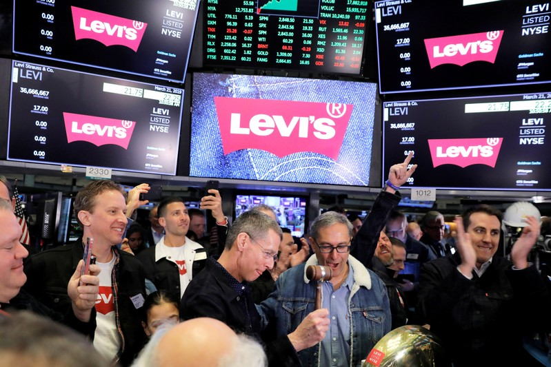 FILE PHOTO: Levi Strauss & Co. CEO Chip Bergh and CFO Harmit Singh ring bell during IPO on floor of New York Stock Exchange (NYSE) in New York