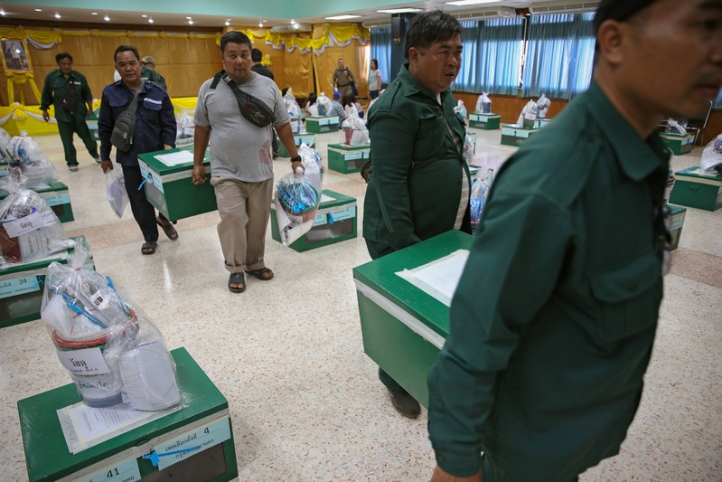 Bangkok district officers prepare ballot boxes and other documents ahead of the general election at a local district office in Bangkok