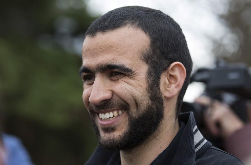 FILE PHOTO: Omar Khadr smiles as he answers questions during a news conference after being released on bail in Edmonton, Alberta