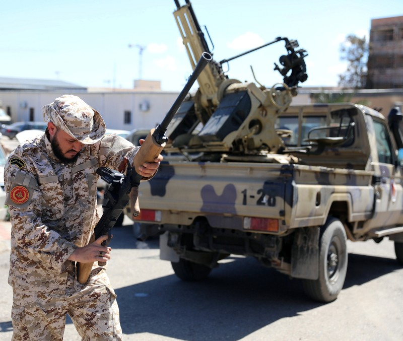 A Member of Misrata forces, under the protection of Tripoli's forces, prepares himself to go to the front line in Tripoli