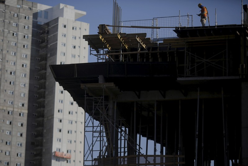 Employee works at a construction site for a residential building in Sao Paulo