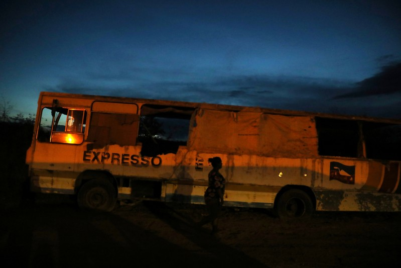 Belki Contreras walks around an abandoned bus at night in the border city of Pacaraima