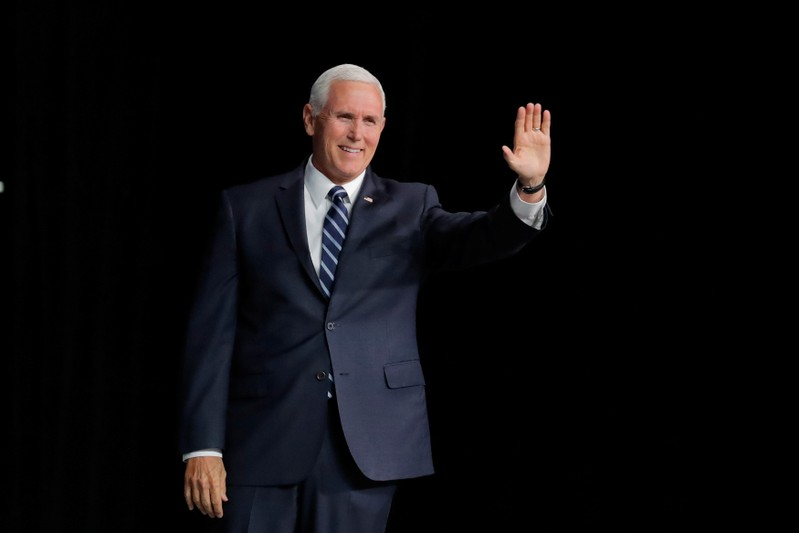 U.S. Vice President Mike Pence acknowledges the audience atthe NRA annual meeting in Indianapolis
