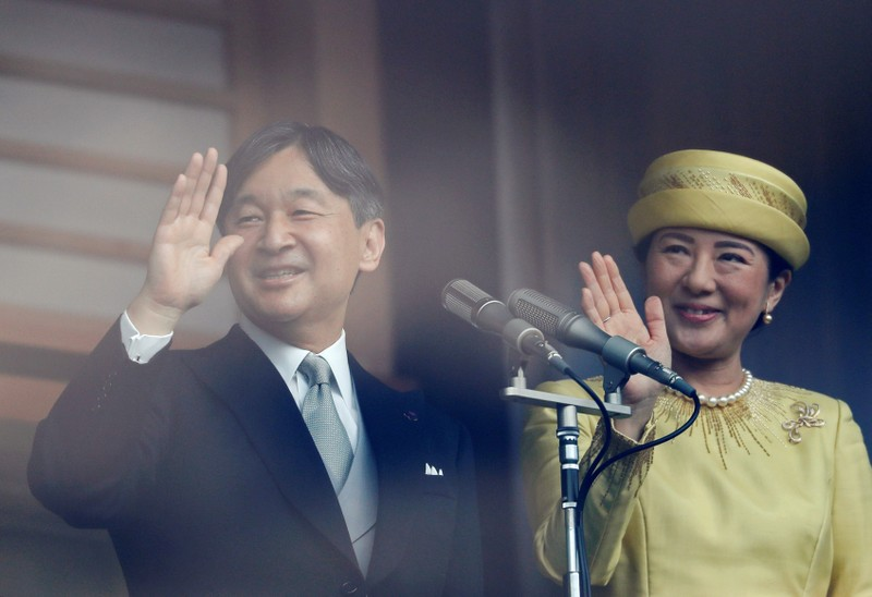 Japan's Emperor Naruhito and Empress Masako greet well-wishers during their first public appearance at the Imperial Palace in Tokyo